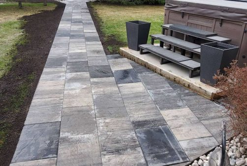 Stone Path with Hot Tub on Right
